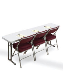 Plastic seminar table with red upholstered folding chairs