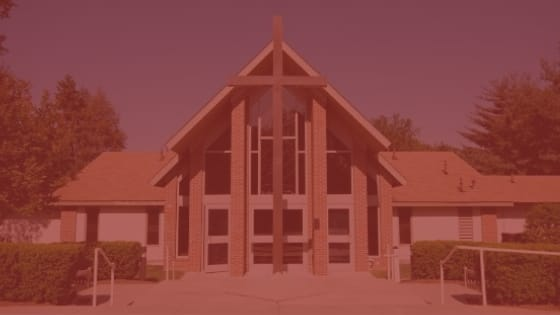 Image of the exterior of a church with red overlay