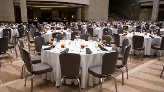 Formal banquet chairs and tables set up at an event venue